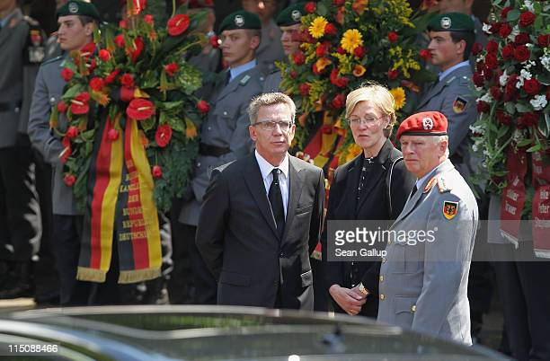 German Defense Minister Thomas de Maiziere , his wife Martina de Maiziere and German military Chief of Staff General Volker Wieker depart after...