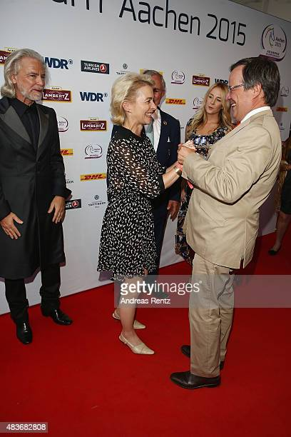 German Defense Minister Ursula von der Leyen and Armin Laschet attend the FEI European Championship 2015 media night on August 11 2015 in Aachen...