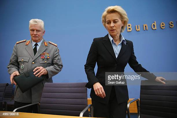 German Defense Minister Ursula von der Leyen and Bundeswehr Chief of Staff Volker Wieker arrive to speak to the media about Germany's pending...