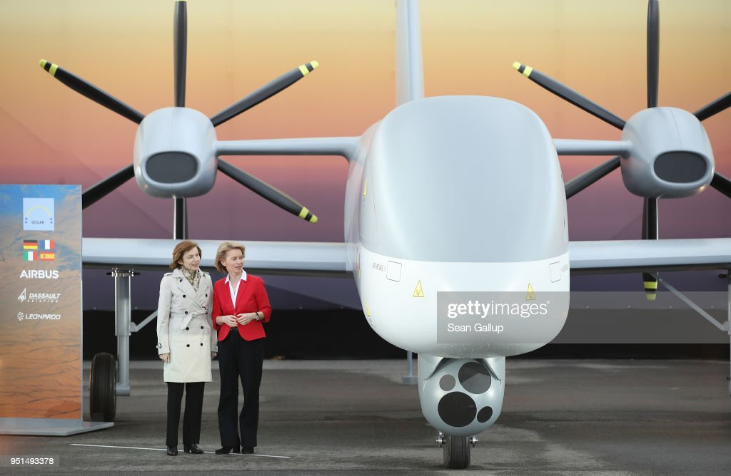 German Defense Minister Ursula von der Leyen (R) and French Defense Minister Florence Parly stand next to the European MALE UAV drone at the Airbus stand at the ILA Berlin Air Show on April 26, 2018 in Schoenefeld, Germany. The medium altitude long endurance (MALE) twin turboprop drone will be a joint project between Dessault Aviation, Airbus Defense and Space and Leonardo.