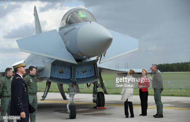 German Defense Minister Ursula von der Leyen and French Defense Minister Florence Parly look at a Eurofighter Typhoon fighter jet at the ILA Berlin...