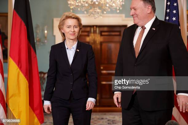 German Defense Minister Ursula von der Leyen and US Secretary of State Mike Pompeo pose for photographs before meeting in the Treaty Room at the...