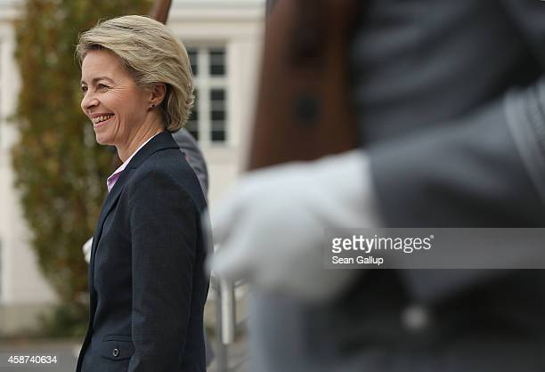 German Defense Minister Ursula von der Leyen emerges to welcome High Representative of the European Union for Foreign Affairs Federica Mogherini at...