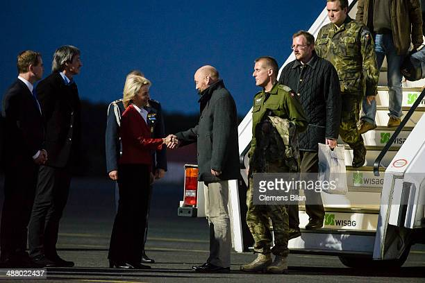 German Defense Minister Ursula von der Leyen greets the freed OSCE observer Axel Schneider and the other mission workers following their release from...
