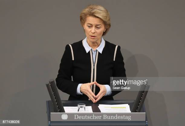 German Defense Minister Ursula von der Leyen makes a hands gesture nearly identical to one that German Chancellor Angela Merkel often shows during...
