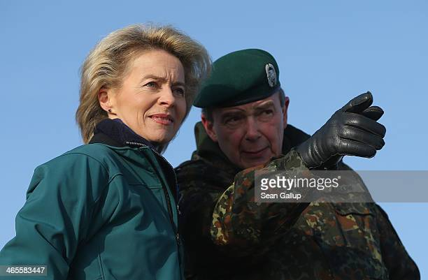 German Defense Minister Ursula von der Leyen observes tanks engaged in military exercises at the Bundeswehr combat training center on January 28 2014...
