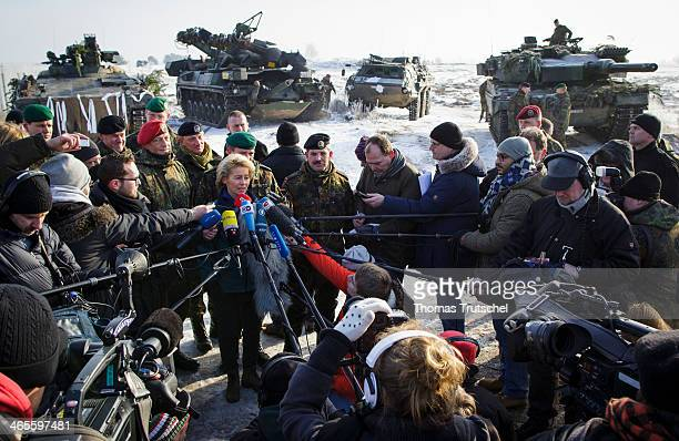 German Defense Minister Ursula von der Leyen speaks to the media at the Bundeswehr combat training center during exercises on January 28 2014 in...