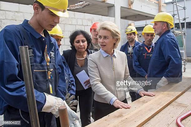 German Defense Minister Ursula von der Leyen speaks with Syrian refugees who have found asylum in Germany at the launch of a program to train Syrians...