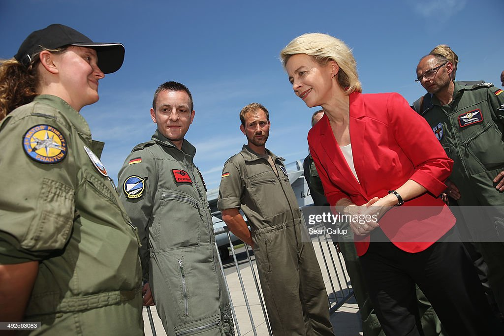 German Defense Minister Ursula von der Leyen strains to see the badge of a member of the Luftwaffe, the German air force, at the ILA 2014 Berlin Air Show on May 21, 2014 in Schoenefeld, Germany. The ILA 2014 is open from May 20-25.