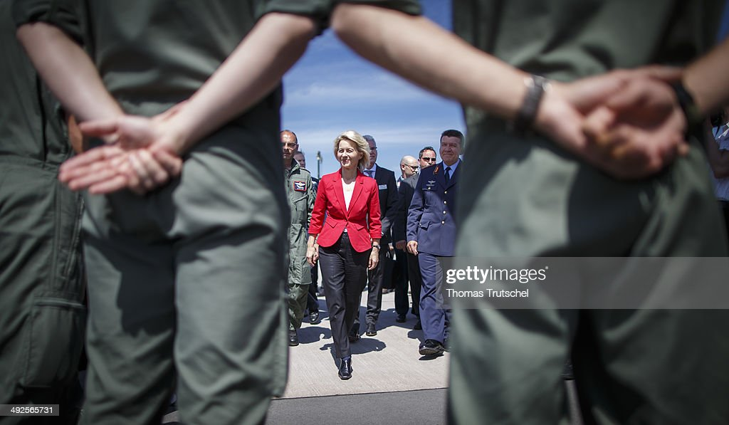 German Defense Minister Ursula von der Leyen (Center) talks to soldiers at ILA 2014 Berlin Air Show on May 21, 2014 in Schoenefeld, near Berlin.
