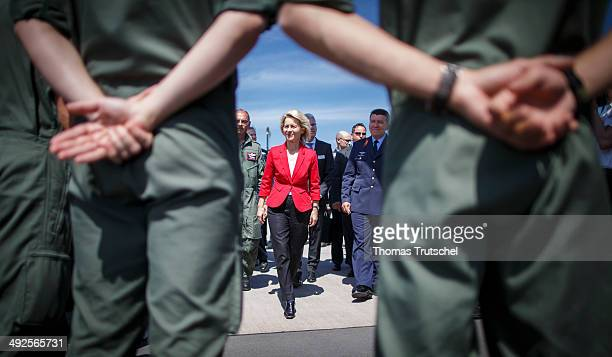 German Defense Minister Ursula von der Leyen talks to soldiers at ILA 2014 Berlin Air Show on May 21 2014 in Schoenefeld near Berlin
