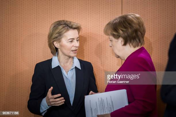 German Defense Minister Ursula von der Leyen talks with German Chancellor Angela Merkel before the weekly cabinet meeting at the chancellery on May...