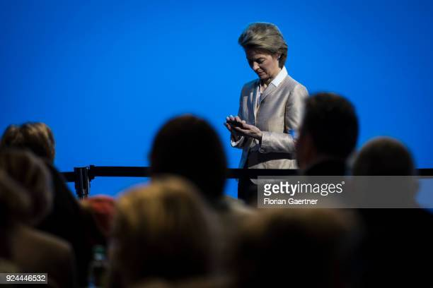 German Defense Minister Ursula von der Leyen works with her smartphone at the 30th German Christian Democrats party congress on February 26 2018 in...
