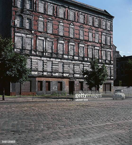 German Democratic Republic Bezirk Berlin East Berlin A bricked facade of a house at the border 1966