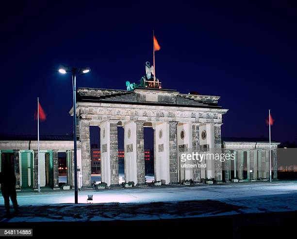"German Democratic Republic Bezirk Berlin East Berlin - ""Brandenburg Gate"" with Berlin wall in the foreground. Night shot"