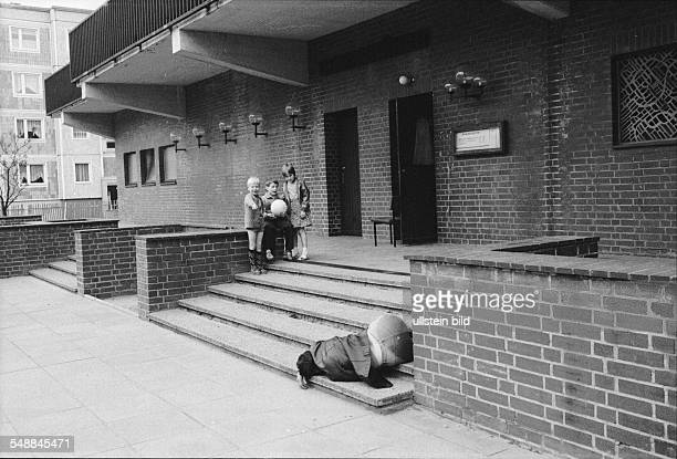 German Democratic Republic Bezirk Berlin East Berlin drunken man and children 1985