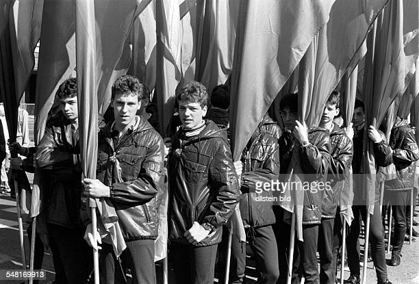 German Democratic Republic Bezirk Berlin East Berlin may rally young comrade with flags