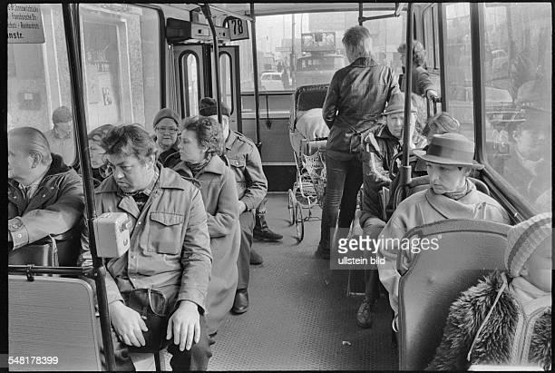 German Democratic Republic Bezirk Berlin East Berlin - people in a bus -