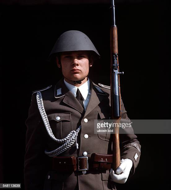 German Democratic Republic Bezirk Berlin East Berlin Soldier of the National Peoples Army during guard of honour in front of the cenotaph Neue Wache...