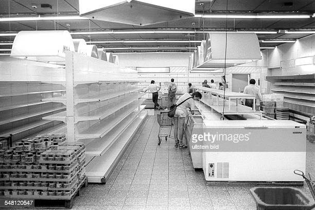German Democratic Republic Bezirk Berlin East Berlin supermarket on the last day before the currency union empty shelves