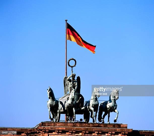 "German Democratic Republic Bezirk Berlin East Berlin - The ""Quadriga"" on ""Brandenburg Gate"" with national flag of GDR."