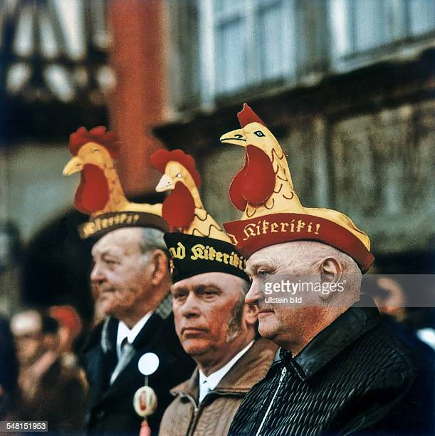 German Democratic Republic Bezirk Erfurt Eisenach - springtime festival 'Sommergewinn', street parade, seniors with fool's cap - um 1982