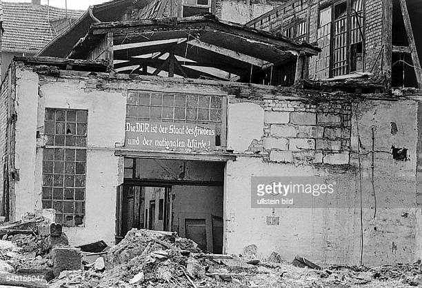 German Democratic Republic Bezirk Erfurt Heiligenstadt slogan of the SED party at a rotten factory building um 1982