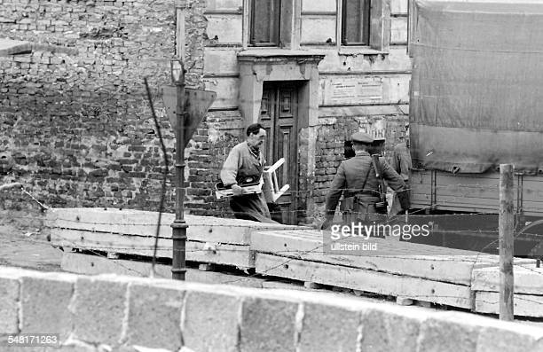 German Democratic Republic East Berlin The building of the wall Bernauer Strasse People are forced to move out of their flats because they are next...