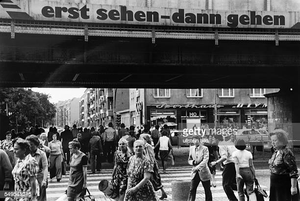 German Democratic Republic, East-Berlin, street scene, people walking at Schoenhauser Allee