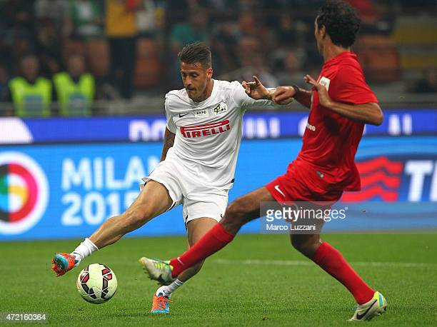 German Denis is challenged by Alessandro Nesta during the Zanetti and friends Match for Expo 2015 at Stadio Giuseppe Meazza on May 4 2015 in Milan...