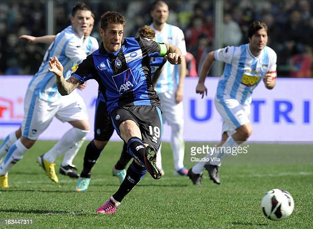 German Denis of Atalanta BC scores his team's first goal from the penalty spot during the Serie A match between Atalanta BC and Pescara at Stadio...