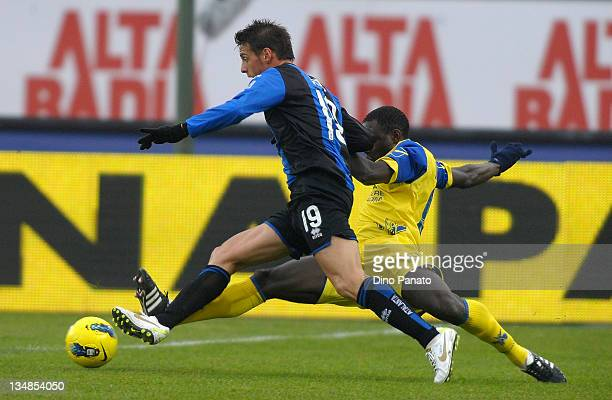 German Denis of Atalanta is challenged by Boukary Drame of Chievo during the Serie A match between AC Chievo Verona and Atalanta BC at Stadio...