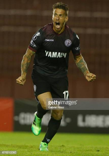 German Denis of Lanus celebrates after scoring the third goal of his team during a group stage match between Lanus and Zulia as part of Copa CONMEBOL...