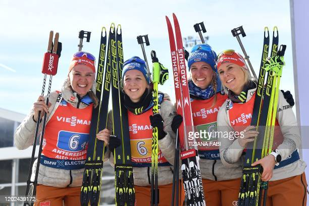 German Denise Herrmann, German Franziska Preuss, German Vanessa Hinz and German Karolin Horchler celebrate on the podium after placing second of the...