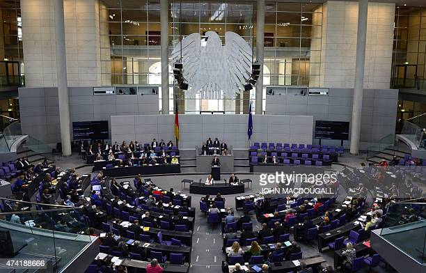 German deputies attend a session at the lower house of Parliament Bundestag on May 21, 2015 in Berlin presenting Germany's position at the talks to...