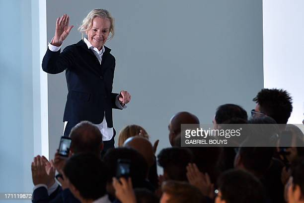 German designer Jil Sander acknowledges the audience at the end of the Jil Sander Spring-Summer 2014 Menswear collection on June 22, 2013 during the...