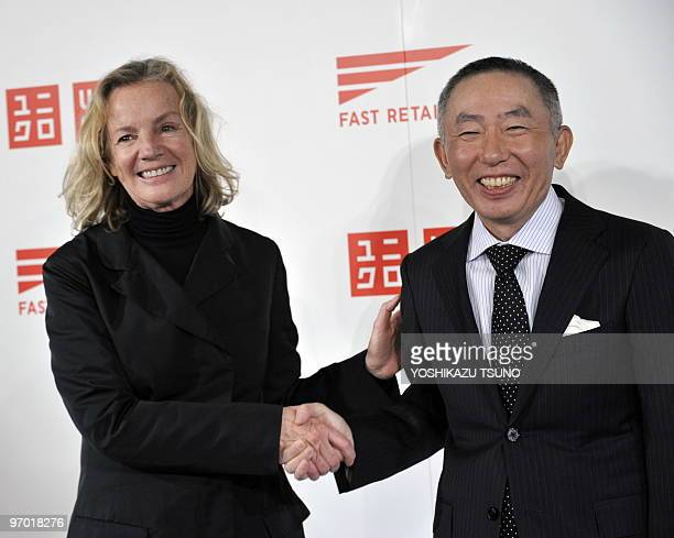 German designer Jil Sander shakes hands with Japan's casual apparel giant Fast Retailing, known as Uniqlo brand, president tadashi Yanai as they...