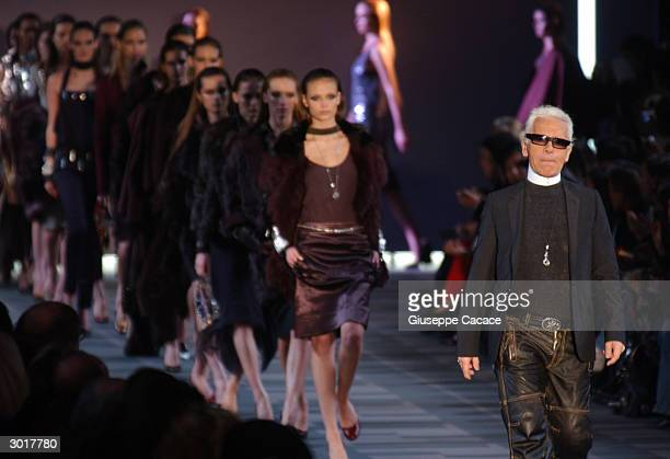 German designer Karl Lagerfeld acknowledge the applauses at the end of Fendi Autumn/Winter 2004 collection during Milan Fashion Week February 26 2004...
