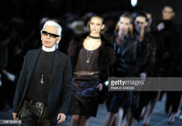 German designer Karl Lagerfeld acknowledges applause on the catwalk at the end of Fendi's Autumn/Winter 20042005 women's collection as part of Milan...