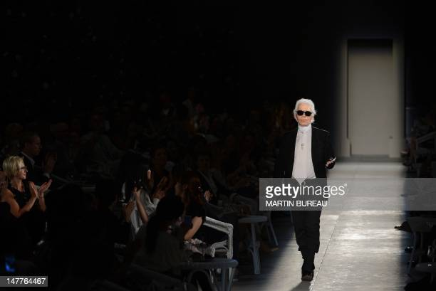 German designer Karl Lagerfeld acknowledges the audience at the enf of his Chanel Haute Couture FallWinter 20122013 show on July 3 2012 in Paris AFP...