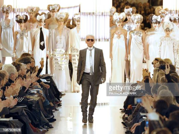 German designer Karl Lagerfeld acknowledges the public after the Chanel spring-summer 2010 haute couture collection show on January 26, 2010 in...
