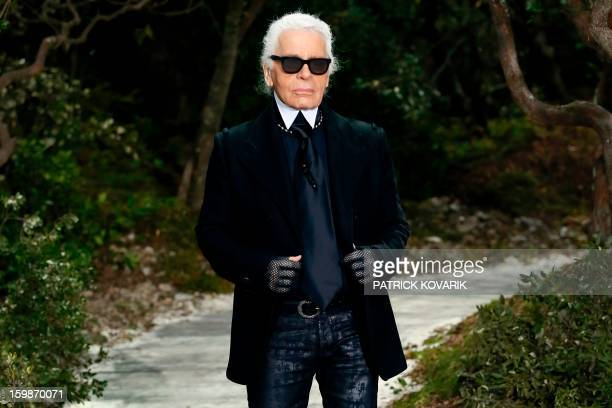 German designer Karl Lagerfeld acknowledges the public at the end of his Chanel Haute Couture SpringSummer 2013 collection show on January 22 2013 at...