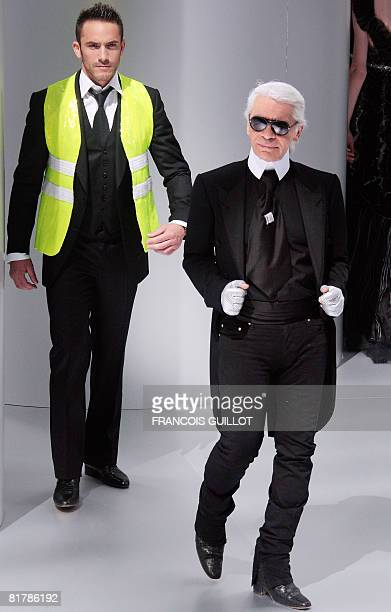 German designer Karl Lagerfeld ackowledges the public at the end of Chanel Fall-Winter 2009 Haute Couture collection show in Paris on July 1, 2008....