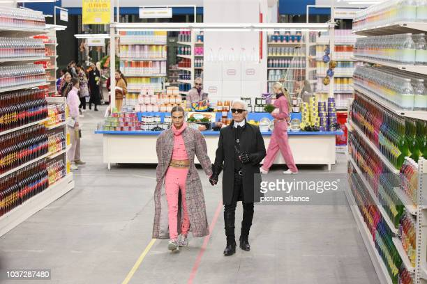 German designer Karl Lagerfeld and british model Cara Delevingne present the Chanel fall/winter 2014 /2015 collection during the Paris Pret a porter...