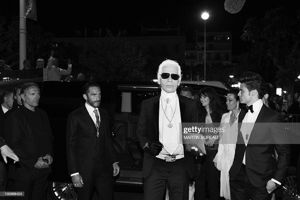 German Designer Karl Lagerfeld arrives to attend the Figaro Madame/Chanel dinner during the 63rd Cannes Film Festival on May 18, 2010 in Cannes.