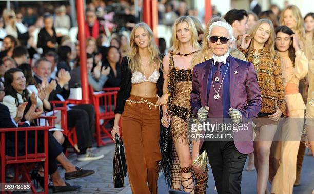 German designer Karl Lagerfeld arrives with his models at the end of the presentation show of the Chanel 2010/11 Croisiere collection on May 11 2010...