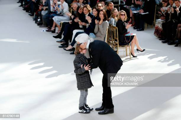 German designer Karl Lagerfeld for Chanel kisses his godson Hudson Kroenig during the 20162017 fall/winter readytowear collection fashion show on...