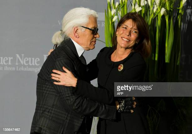 German designer Karl Lagerfeld gives to Princess Caroline of Monaco the charity Award of association People in Europe on December 12 2011 in Passau...