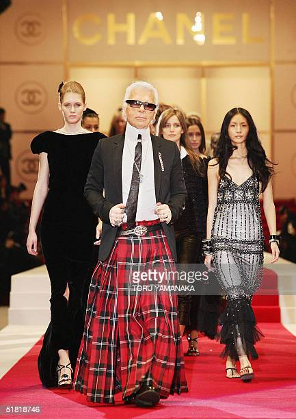 German designer Karl Lagerfeld of French fashion giant Chanel walks with models during the 2005 spring/summer pretaporter collection at a makeshift...