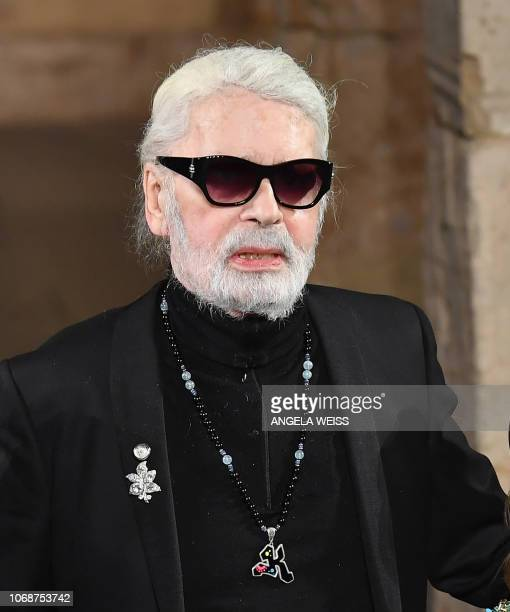 German designer Karl Lagerfeld poses on the runway during the Chanel Metiers D'Art 2018/19 Show at The Metropolitan Museum of Art on December 04 2018...